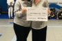 ECC Principal Amy Seeds presents a $1,000 check to Olsen Elementary School in Port Aransas ISD. The money was raised through the